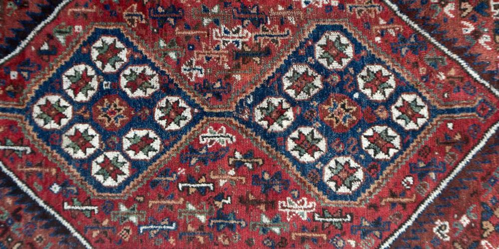 Old or antique Qashqa'i tribal Persian rug