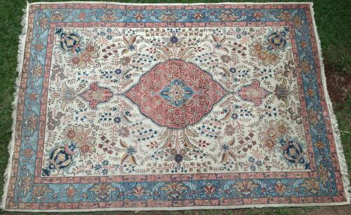Old or antique Tabriz Persian carpet