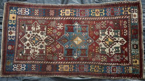 Antique tribal Caucasian Kazak rug
