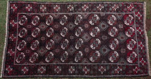 Old Baluch Afghan or Persian Tekke design rug