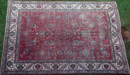 Old or antique Tabriz Persian carpet